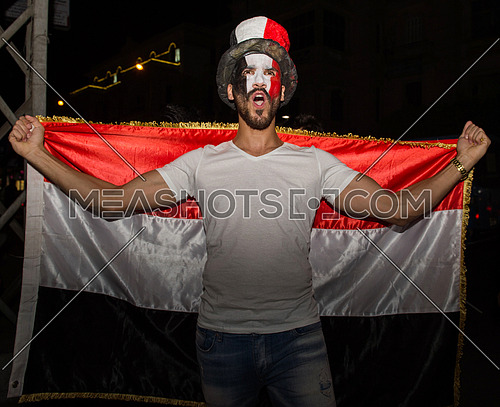 Some young people in the street are encouraging the Egyptian football team and the joy of their arrival at the World Cup in Russia
