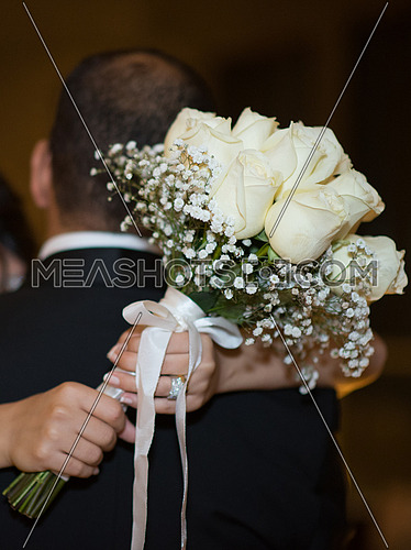 Bride Holding Bunch of Flowers in her wedding