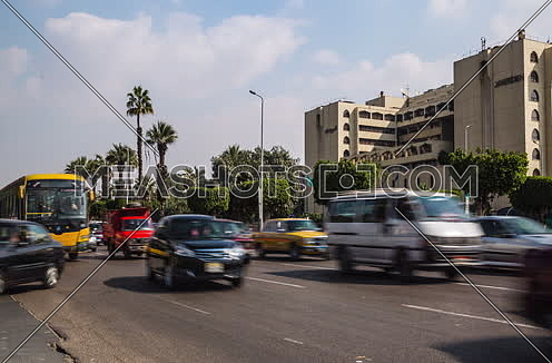 Track Right Shot for traffic at Salah Salim Street showing Le Meridien Hotel in background