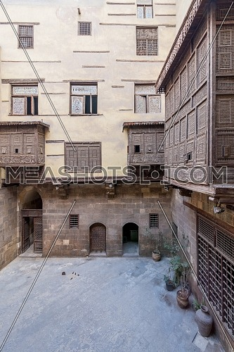 Facade of ottoman era historic house of Zeinab Khatoun with wooden oriel windows - Mashrabiya - located at Azhar district, Medieval Cairo, Egypt
