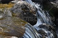 Brook water stream with small rift in day time