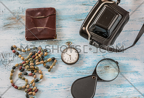 Travel concept with old camera,wallet pocket watch and magnifyin