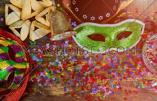 Jewish carnival Purim celebration on wood background view from above hamantaschen homemade cookie