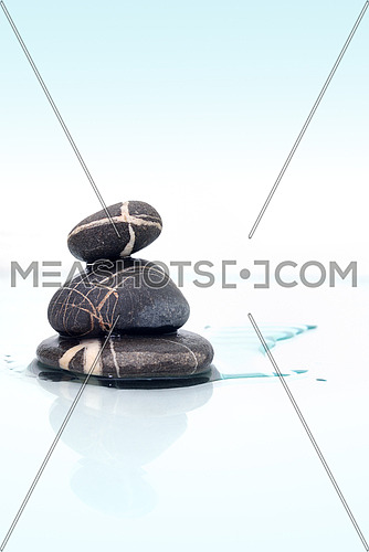 wet zen stones on a white background