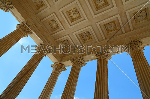 Low angle view of ceiling and Corinthian columns of Maison Carree (square house), ancient building in Nimes, Provence, southern France