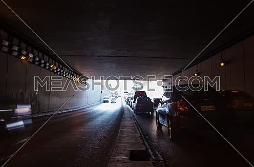 Track Right Shot for traffic from inside  Al Thawra Tunnel at Daytime