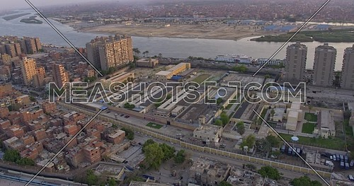 Aerial shot for the city beside the River Nile while Metro Stopped in Cairo at sunset