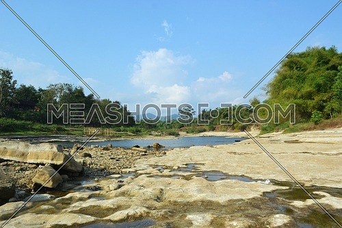 Bogowonto River, Purworejo / Indonesia - July 22, 2020: Bogowonto River is Dry Season with Many Trees on the Edge During the Day