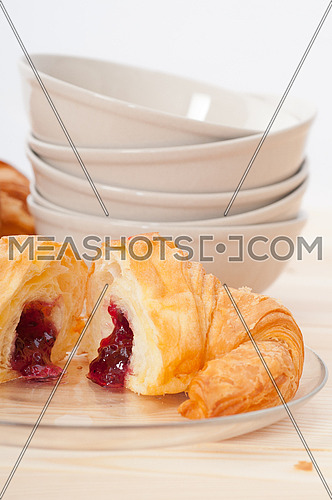 fresh baked croissant French brioche filled with berries jam