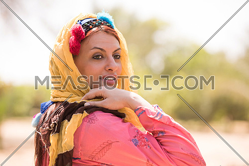 portrait of a young beautiful middle eastern woman with a smile on her face on a sunny summer day