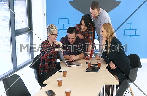Concept of teamwork in beautiful and trendy startup office
