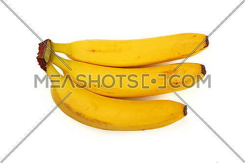 Bunch of three fresh yellow bananas isolated on white background, close up, elevated top view, high angle
