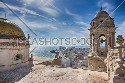 Cadiz Spain- March 31: This bell tower and statues in the roof of the Cathedral of Cadiz, completed in the nineteenth century is located very close to the sea, take in Cadiz, Andalusia, Spain Western Europe