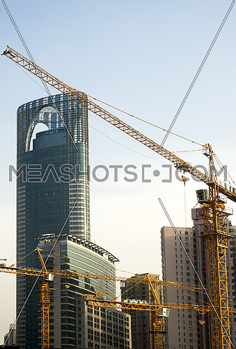 shanghai construction crane over modern building background