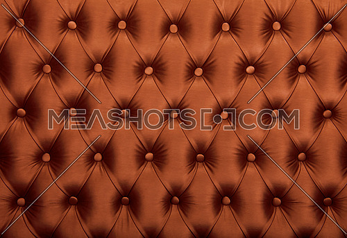 Brown capitone textile background, retro Chesterfield style checkered soft tufted fabric furniture diamond pattern decoration with buttons, close up