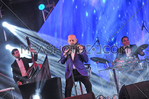 Romanian pan flute master Gheorghe Zamfir performs during a concert in the Egyptian capital Cairo on January 19, 2018 The event was a charity for the International Society of Oncology (BGICS) under the slogan