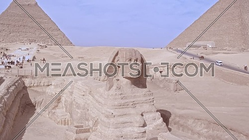 360 Shot Drone for The Sphinx showing Menkaure Pyramid and Khafre Pyramid then The Great Pyramid of Khufu in background in Giza at day