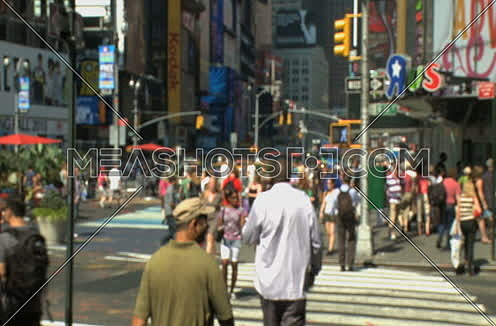 Long shot for Pedestrians walking through Times Square at day.