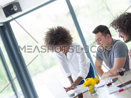 Multiethnic Group of business people discussing business plan  in the startup office