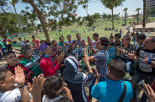 egyptian Youth group sings in the park to celebrate Eid al-Fitr