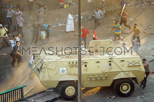 protesters attack armored forces of the armed forces in front of the Ministry of Finance of egypt on the day of the dismantling Rabaa al-Adawiya Square sit-in On 14 August 2013