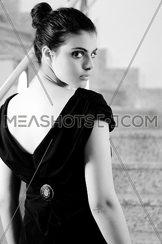 beautiful young lady in black dress shoot from back