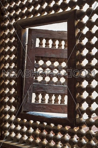 Wooden latticed window (Mashrabiya) with one small swinging sash, Zeinab Khatoun historic house, Old Cairo, Egypt