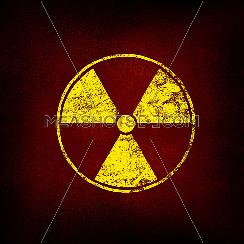 Yellow radioactive hazard warning sign painted over grunge brown and black background with copy space