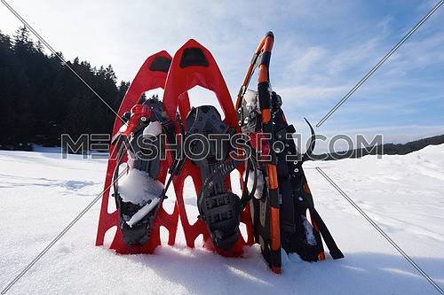 snowshoes in fresh show on beautiful winter sunny day