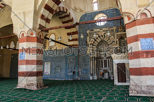 a photo from the blue mosque in old Fatimid Cairo (sonkor ) showing the architecture style and blue color used and the prayers direction in Egypt