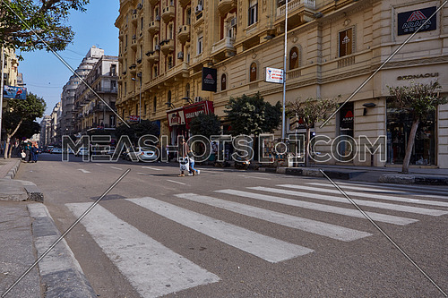 Long shot for pedestrain crossing Sherif Basha Street at cairo at Day