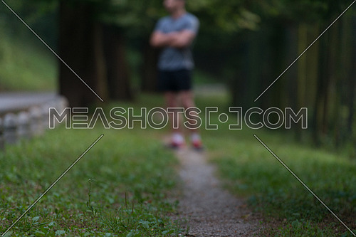 Portrait Of Young Man Doing Outdoor Activity Running - Motion Blurred Image
