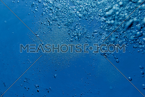 air bubbles in clear blue ocean water