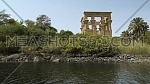Track shot for Temple of Philae li from the boat in the River Nile at Aswan - Egypt by day