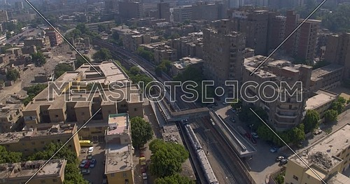 Follow shot for Metro then revealing the City of Cairo at day