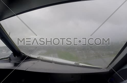 inside cockpit shot for plane taking off at rainy day