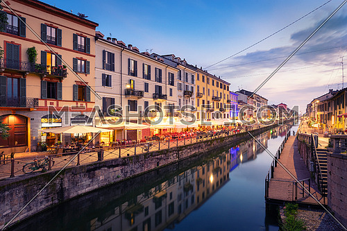 Naviglio Grande canal at the evening.when the lights of the city and the bars come on and the nightlife of Milan begins, Milan, Italy.