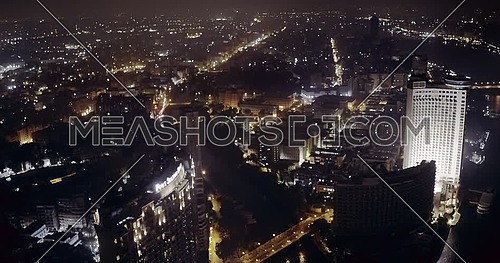 Drone Fly over Cairo Starting from the River Nile and towards showing The Four Seasons Hotel at night