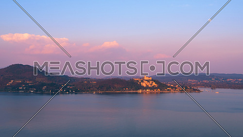 Fortress of Angera (Rocca di Angera), view from Arona at sunset, lake Maggiore,Italy.