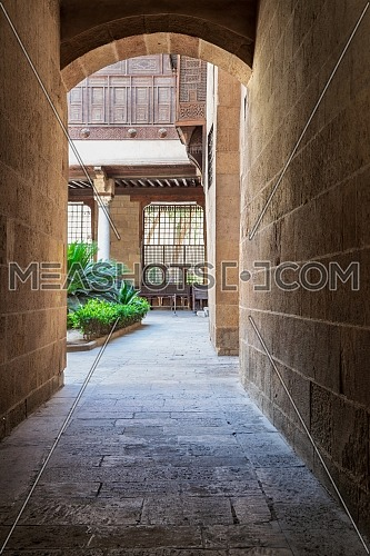 Stone bricks vaulted entrance of ottoman era historic Beit El Sehemy house located in Moez street, Gamalia district, Cairo, Egypt