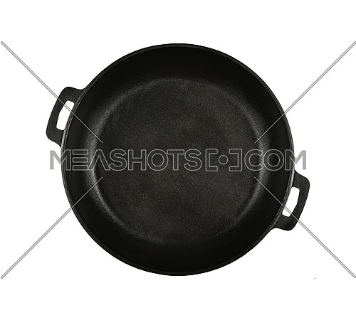 Close up one empty black cast iron frying pan isolated on white background, elevated top view, directly above