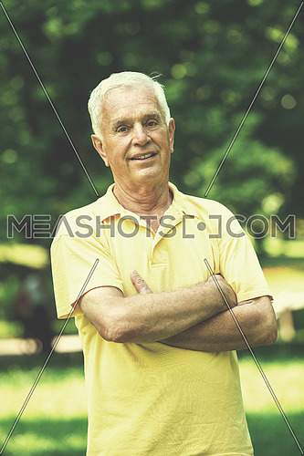 Portrait of smiling elderly man outdoor in park