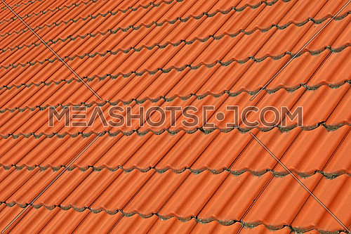 Traditional red brown ceramic roof tiles pattern background, close up, low angle view, diagonal perspective