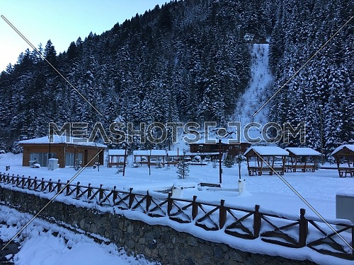 Long shot for Uzungöl (Long Lake) covered with snow - Trabzon, Turkey in the winter by the day.