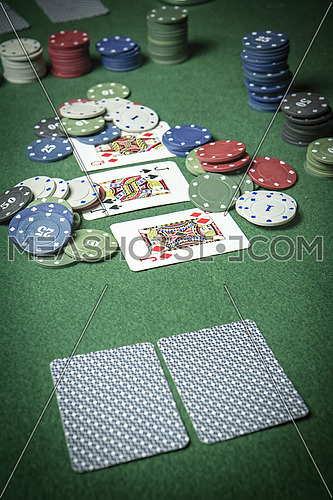 cards poker deck English, poker chips stack on green table