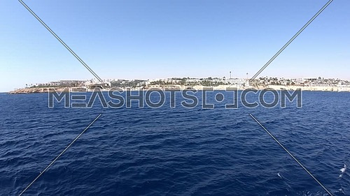 Long shot form a boat showing Sharm El Shaikh City at day