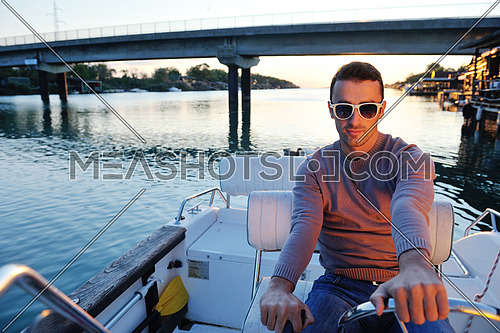 happy young man have fun at boat at sunset on summer season