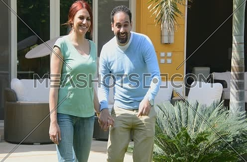 middle eastern family walking in house garden