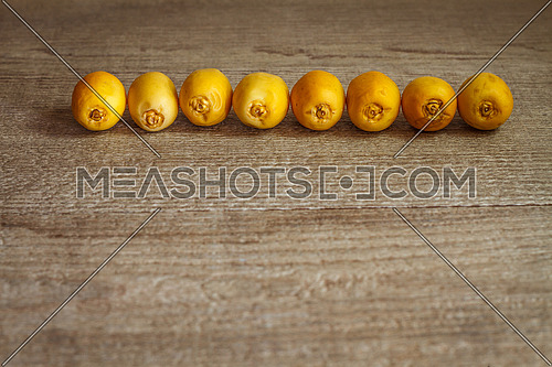 Yellow dates arranged in a row