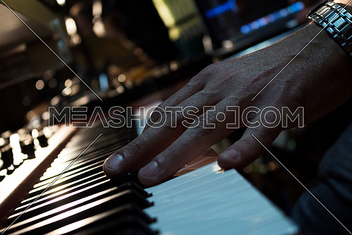 Piano Keyboards In Music Studio And A Hand Of A Musician